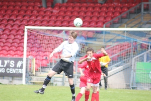 Ross Slevin wins a header